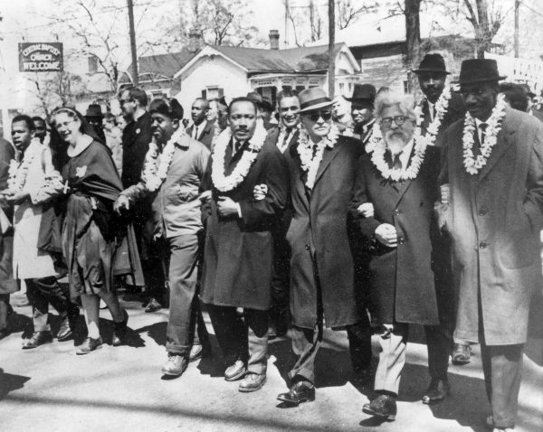 Selma to Montgomery, Alabama March 21, 1965. March leaders (wearing leis) from left to right: John Lewis, a nun, Ralph Abernathy, Martin Luther King, Ralph Bunche, Rabbi Abraham Joshua Heschel and Gregory W. Meeks