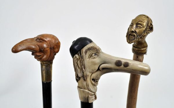 19th-century European walking sticks decorated with caricatures of Jewish faces.