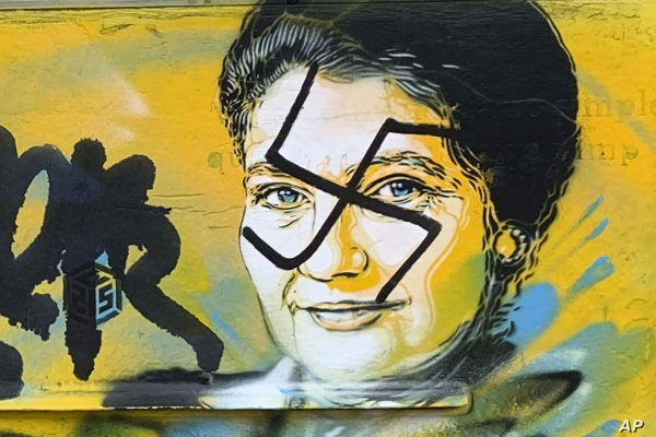 Street portraits of the prominent Holocaust survivor and politician Simone Weil, painted on mailboxes in Paris, were graffitied with swastikas, in 2019.