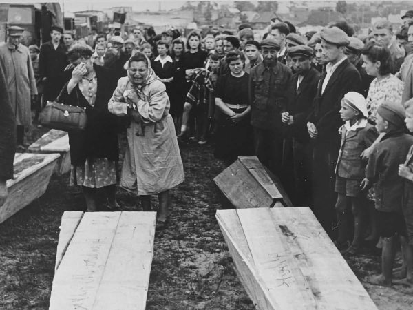 Women grieving over the coffins of victims of the Kielce pogrom in Poland, 1946.