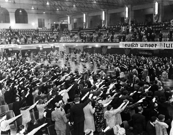 The audience at a Nazi rally in White Plans, NY on April 24, 1938, gives a Nazi salute.
