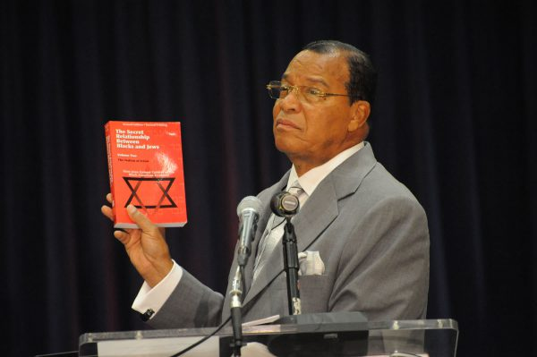 Louis Farrakhan with his book, The Secret Relationship Between Blacks and Jews.